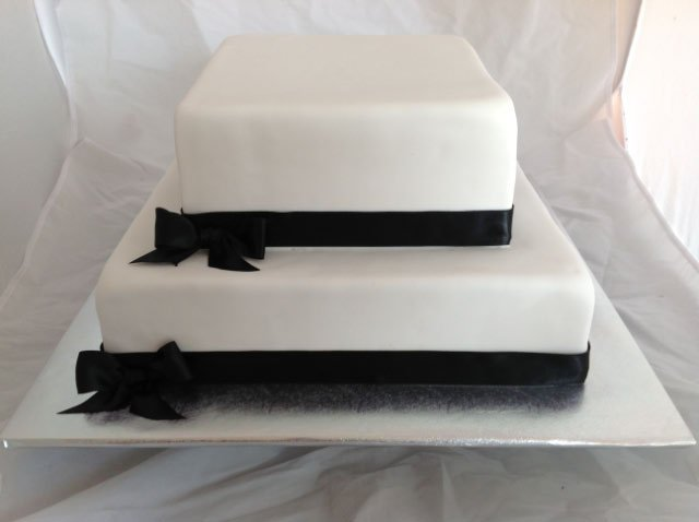 Celebrate Cakes Adult Birthday Cake two tiered with black ribbon
