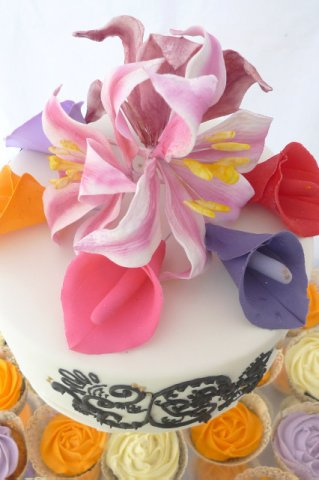 Celebrate Cakes Sugar Flowers - A sugar pink oriental lilies surrounded by brightly coloured calla lilies