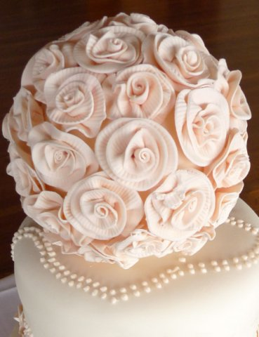 Celebrate Cakes Sugar Flowers -  A ball of ribbon-style roses