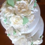 Celebrate Cakes Sugar Flowers - cascade of blossoms including gold tipped sugar roses, sugar orchids and filler blossoms and greenery