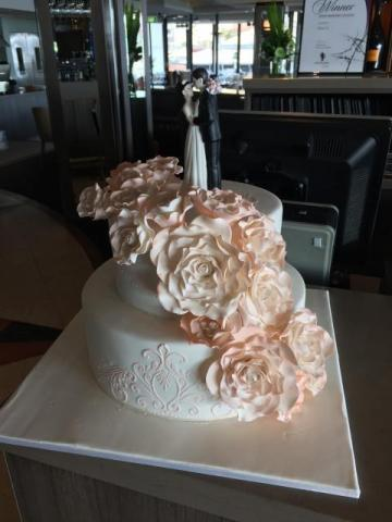 Celebrate Cakes - Wedding Cake with sugar roses and raised top layer