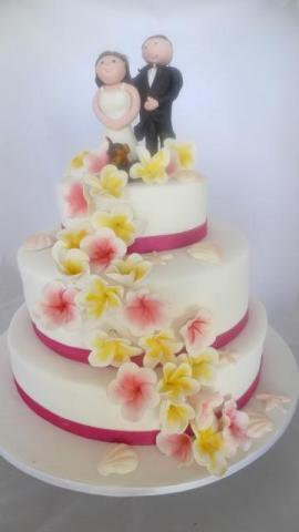 Celebrate Cakes - Wedding Cake with three ties and flowers and ribbons